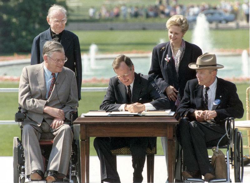 George-Bush-signs-diabilities-act
